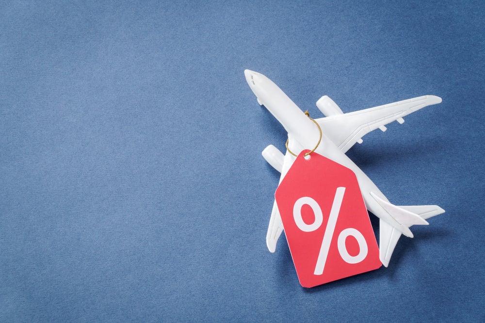 modèle réduit d'avion avec symbol de pourcentage